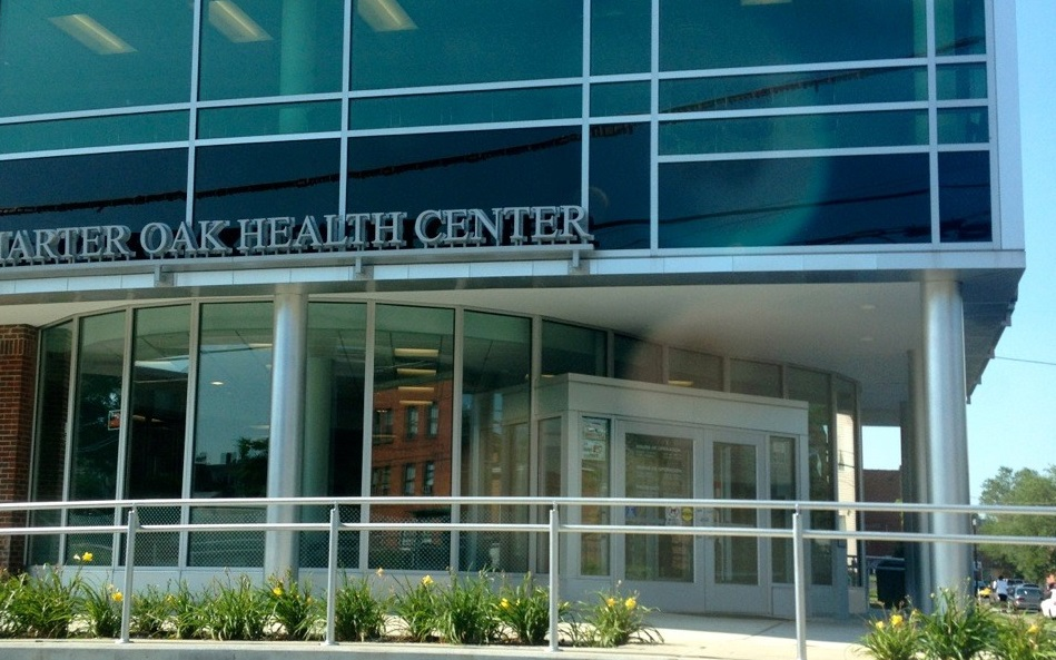 Troubled health center gets millions in state, federal aid